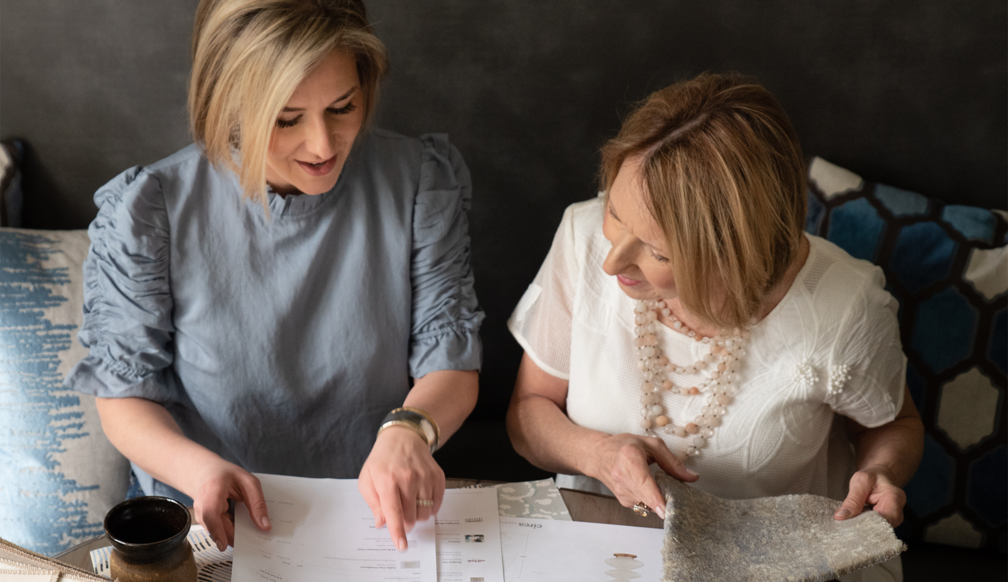 West Trade interior designers discussing a project